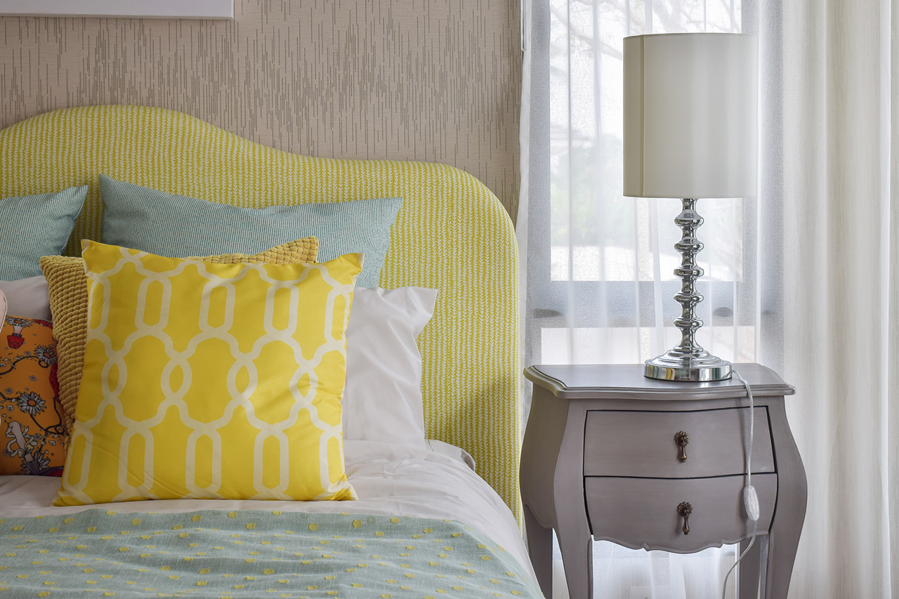 pattern pillows on classic style bed and reading lamp